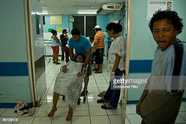 A young man yawns after being attended to in Manolo Morales hospital emergency department for being attacked and robbed in a Managua street for his...