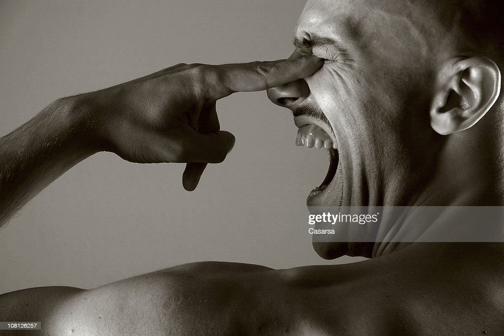 Young Man Yelling and Poking Himself in Eyes, Sepia Toned : Stock Photo