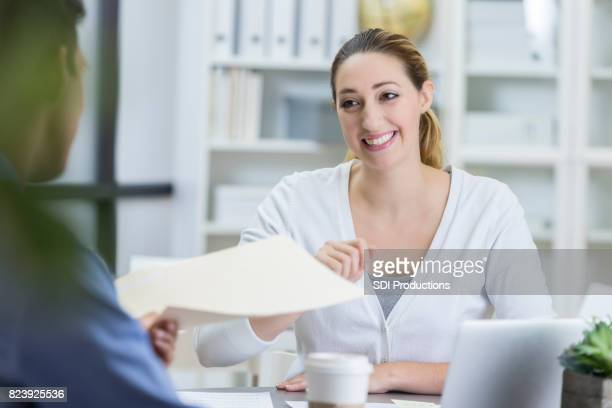 handing resume stock photos and pictures getty images