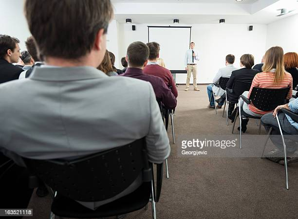 young manager giving presentation to his colleagues - big mike stock pictures, royalty-free photos & images