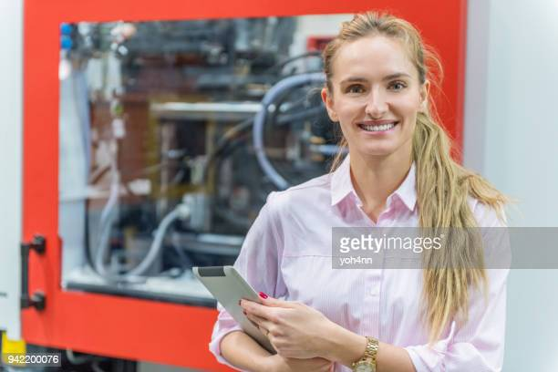 young manager in industrial factory - mechatronics stock pictures, royalty-free photos & images