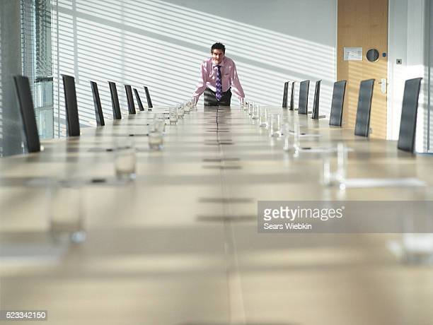 Young Manager Standing at Conference Table
