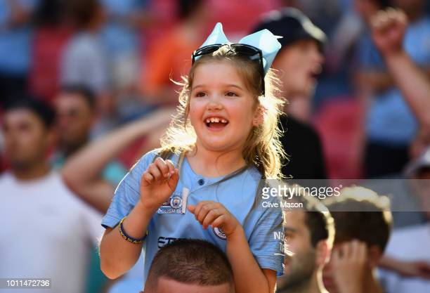 A young Manchester City fan celebrates her side's victory during the FA Community Shield between Manchester City and Chelsea at Wembley Stadium on...