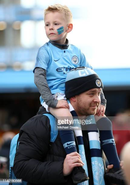 A young Manchester City fan looks on prior to the Premier League match between Manchester City and Cardiff City at Etihad Stadium on April 03 2019 in...