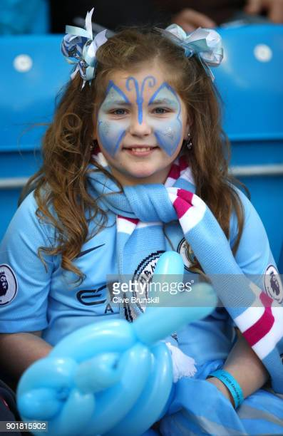 A young Manchester City fan looks on with face paint prior to The Emirates FA Cup Third Round match between Manchester City and Burnley at Etihad...