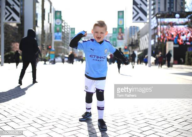 Young Manchester City fans gather outside the stadium prior to the Carabao Cup Final between Aston Villa and Manchester City at Wembley Stadium on...