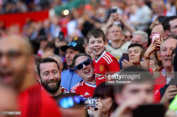 A young Manchester United fan cheers his team during the Premier League match between Manchester United and Leicester City at Old Trafford on...