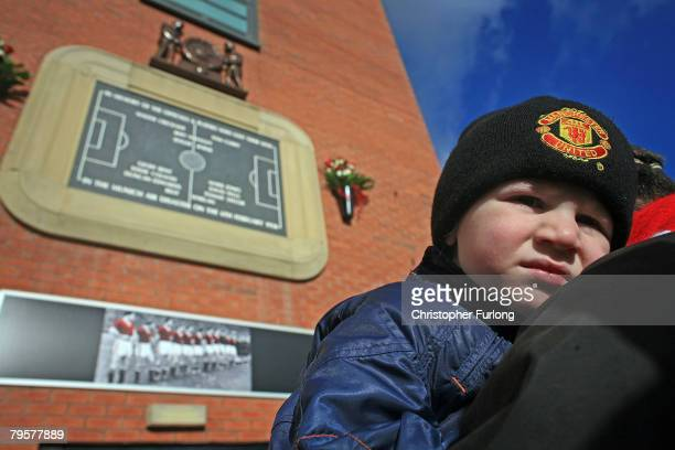 Young Manchester United fan Daniel Welford aged two of Sale pays his own tribute to the 'Busby Babes' on his first ever vist to Old Trafford with his...