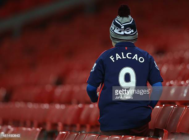 A young Manchester United fan in a Falcao shirt watches from the stand during the FA Youth Cup Fourth Round match between Manchester United U18s and...