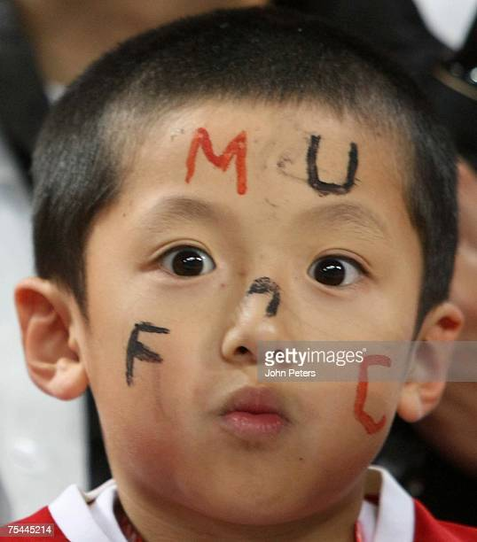 A young Manchester United fan watches from the stand during the preseason friendly match between Urawa Red Diamonds and Manchester United at Saitama...