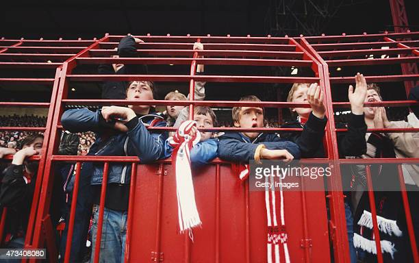 Young Manchester United fans look on through the fence during a First Division match at Old Trafford circa september 1980 in Manchester England