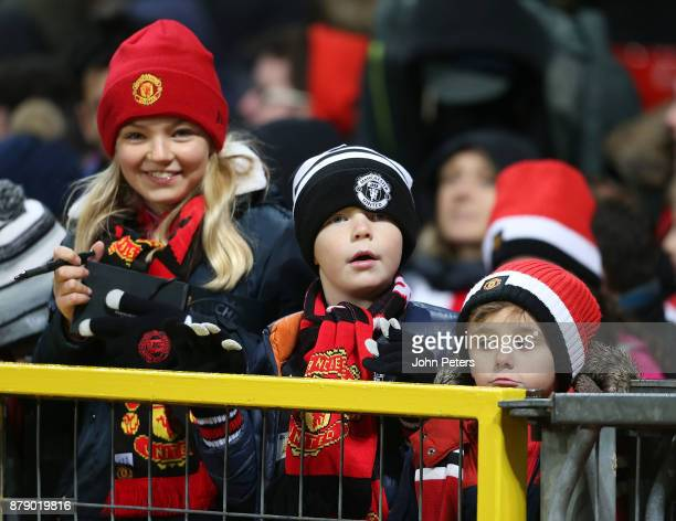 Young Manchester United fans watches from the stand during the Premier League match between Manchester United and Brighton and Hove Albion at Old...