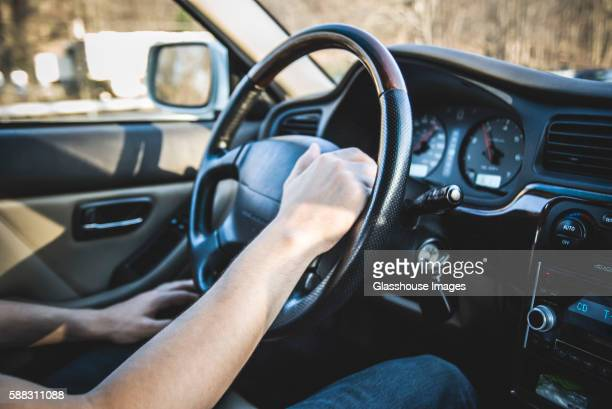 Young Man's Hand on Steering Wheel, Car Interior