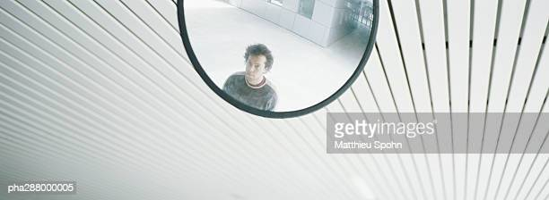 Young man's reflection in mirror