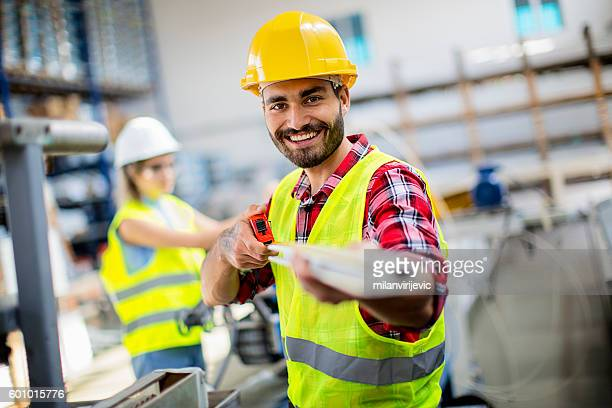 Young manual worker smiling