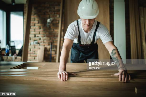 young manual worker working at construction site in the apartment. - foundation make up stock pictures, royalty-free photos & images