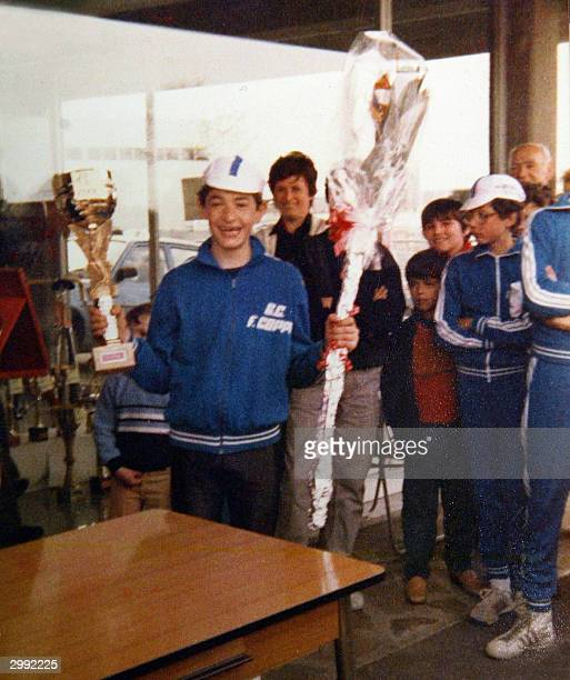 Young Marco Pantani, who was to become one of Italy's top international cyclists, holds a trophy after his first victory in a cycling race, in 1983,...