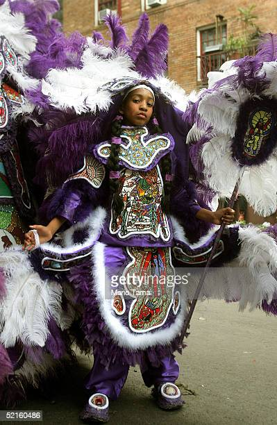 A young Mardi Gras Indian appears during Mardi Gras festivities February 8 2005 in New Orleans Louisiana The Mardi Gras Indians are comprised mostly...