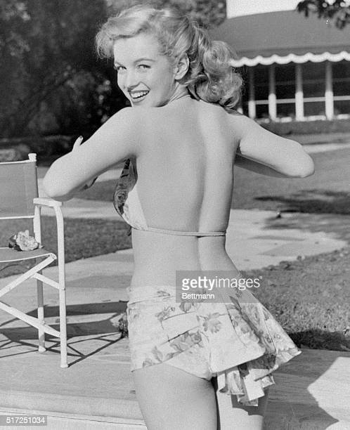 Young Marilyn Monroe about 21 in a bikini at a swimming pool