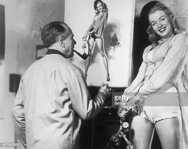 Young Marilyn Monroe poses for painter Earl Moran, for a picture in a calender.