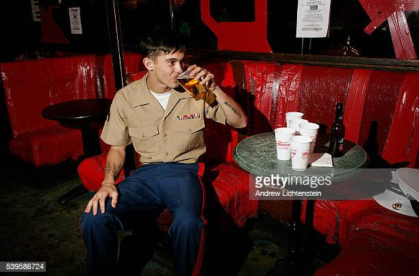 A young marine drinks a beer at a west side bar during New York's annual Fleet Week when dozens of navy ships visit the city
