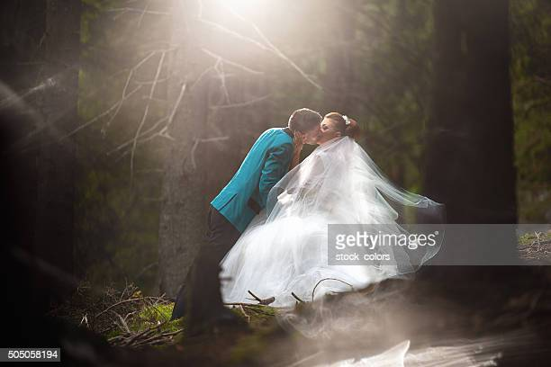 young married couple kissing
