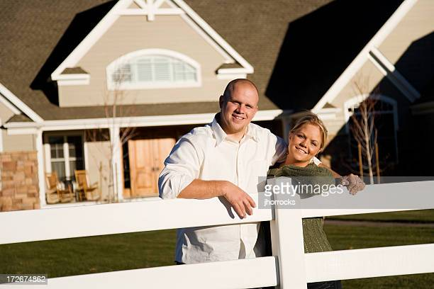 Young Married Couple Leaning on Fence at Home
