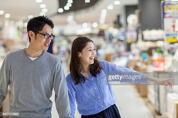 Young married couple shopping in a department store