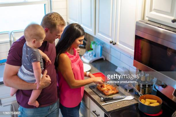 young married millennial multi-ethnic couple cooking in kitchen with toddler child - eyecrave  stock pictures, royalty-free photos & images