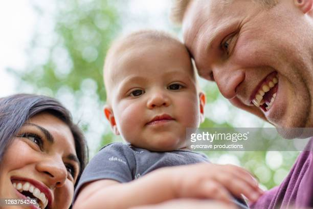young married millennial multi-ethnic couple outdoors with toddler child - eyecrave  stock pictures, royalty-free photos & images