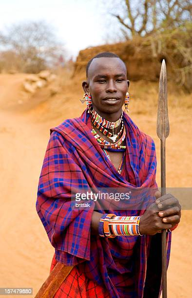 Young Masai warrior with spear and traditional dress, Kenya.