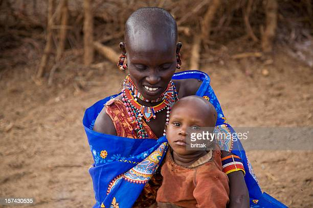 Young masai woman with child. Kenya Esst Africa.