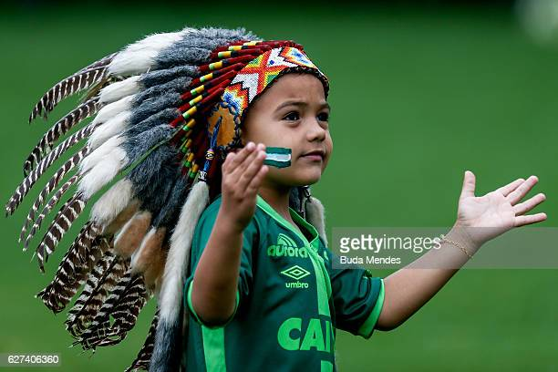 A young mascot pays tribute to the players of Brazilian team Chapecoense Real at the club's Arena Conda stadium in Chapeco in the southern Brazilian...