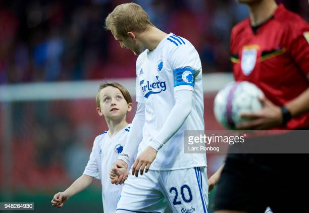 A young mascot speaks to captain Nicolai Boilesen of FC Copenhagen prior to the Danish Alka Superliga match between FC Copenhagen and AaB Aalborg at...