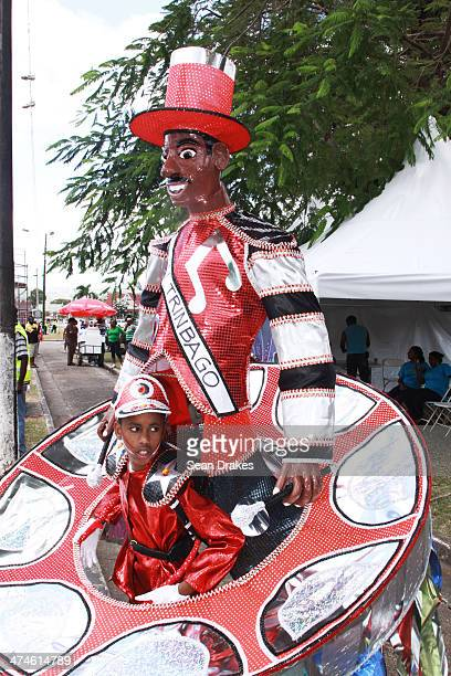 A young masquerader awaits to perform on stage at Junior Panorama on Sunday February 23 2014 in Port of Spain Trinidad