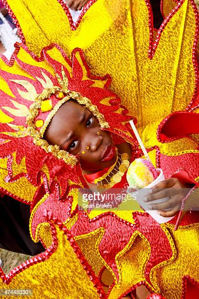 A young masquerader in the Divas Legends band by Bois Canot Productions leads her group to the stage at the Red Cross Junior Carnival competition on...