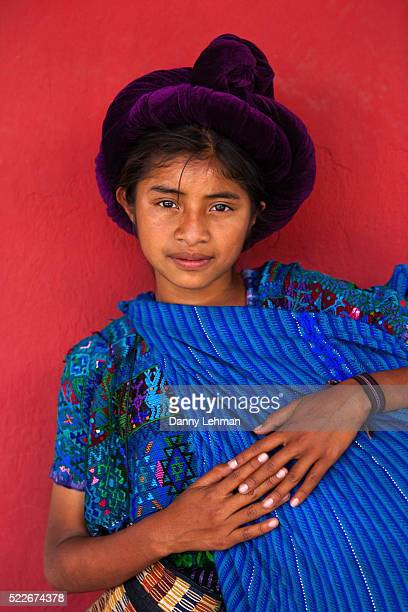 Young Mayan woman in colorful native dress in Antigua