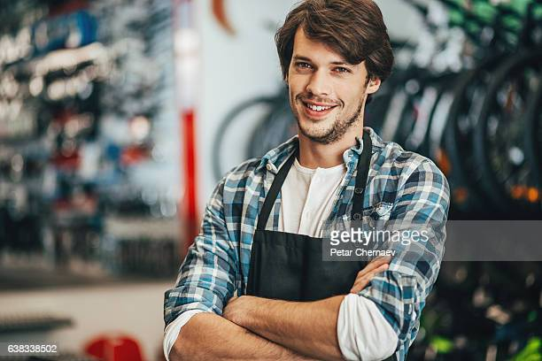 Young mechanic in a bike shop