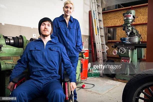 young mechanics / apprentices in a workshop
