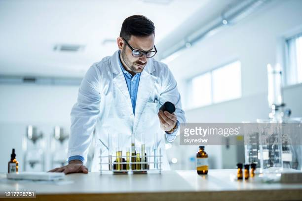 young medical expert working on a virus medicine in laboratory. - medical cannabis stock pictures, royalty-free photos & images