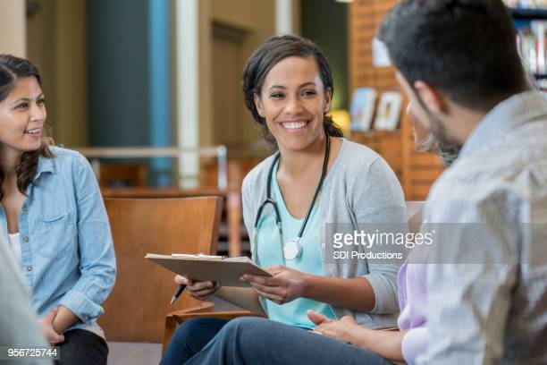 young medical instructor sits in a circle with students - administrator stock pictures, royalty-free photos & images