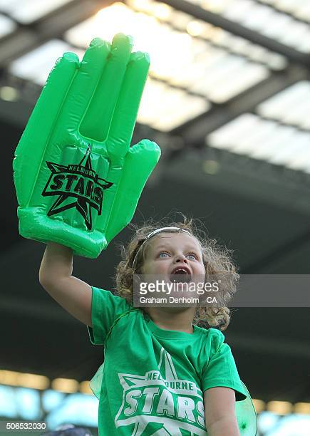 A young Melbourne Stars fan shows her support during the Big Bash League final match between Melbourne Stars and the Sydney Thunder at Melbourne...