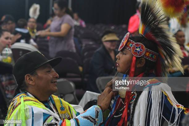 A young member of the First Nations getting ready to perform a traditional dance during the third annual traditional Pow Wow competition at the KDays...