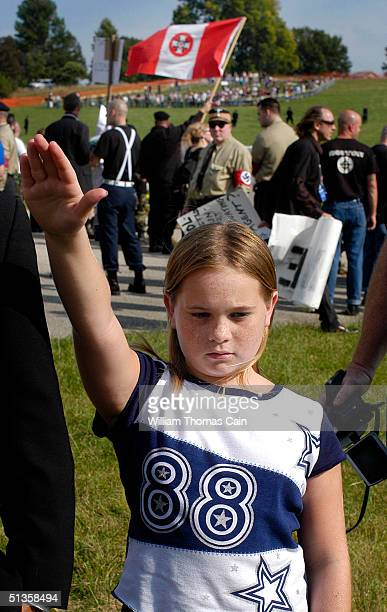 Young member of the Ku Klux Klan salutes during American Nazi Party rally at Valley Forge National Park September 25, 2004 in Valley Forge,...