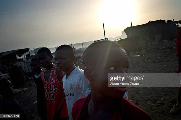 Young members of a local football team taking part in training on the main pitch in the Agbogbloshie slum in Accra Ghana There are many young people...