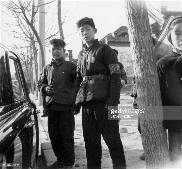 Young members of Red Guards high school and university students patrol in late 1966 in Beijing's streets to spread Mao's thought during the Great...