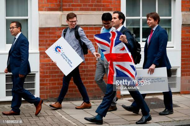 Young members of the Conservative Party arrive to protest their opposition to leaving the European Union with a deal outside the Conservative...