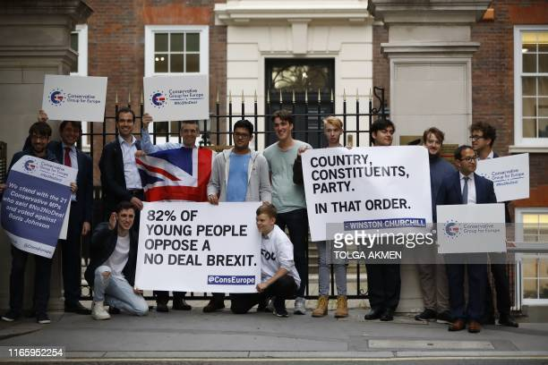 TOPSHOT Young members of the Conservative Party protest their opposition to leaving the European Union with a deal outside the Conservative Campaign...