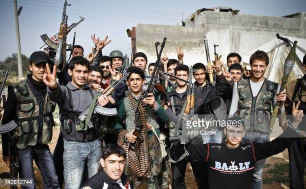 Young members of the Free Syrian Army show off their weapons before a failed counterattack against government forces in Saraquib city on April 9 2012...