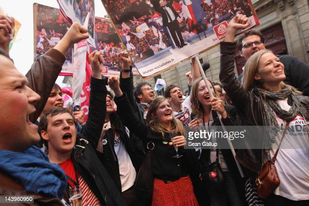 Young members of the French Socialist Party celebrate outside the party's headquarters following the announcement of a strong result for Socialist...